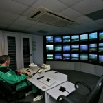 man monitoring screens